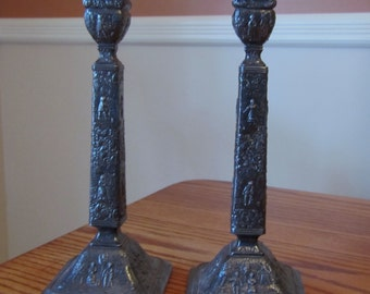 Early Jenning Bros. Embossed Dutch Folk Scene 11 Inch Silver Plated  Candlesticks