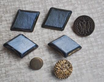 Vintage brass-plastic buttons.