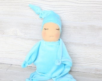 """Ready to ship Waldorf inspired """"star"""" baby in baby blue."""