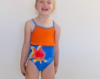 Girls one piece bathing suit with goldfish and orange frill.