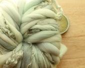RESERVED Seafoam Curls - Thick and Thin Handspun Merino Wool Yarn Mint Blue Green