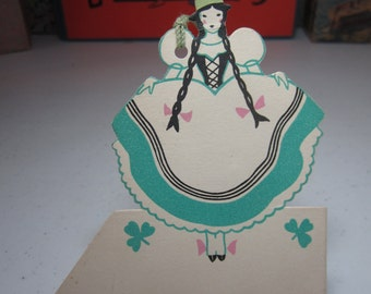 Darling unused art deco die cut 1930's Gibson St.Patrick's Day bridge tally place card lady in irish dress and top hat w/ long braids clover