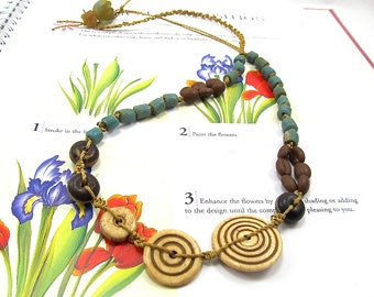Carved Bone Swirl Macrame, Knotted Bohemian Tribal Necklace, African Trade Bead Necklace. Blue Clay and Brown DZI Agate Gypsy Boho Necklace