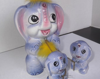 Elephant Family Chained Together Pink/Purple/Blue Ceramic Collectible Elephants Set of three Collectible Figurines