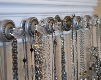 "REDUCED 20% off- White jewelry organizer.Sleek one of a kind necklace rack w/double knobs offers 2x's the jewelry storage 20"" with 13 knobs"