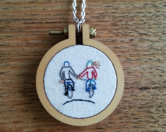 Hand embroidered ready made cycling couple with chain