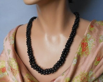 Black torsade necklace, 1960s black three strand faux pearl, twisted black cabochon clasp.