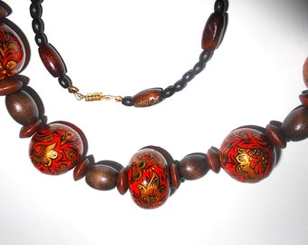 Wooden bead in Russian folk style Khokhloma in handmade gold on red
