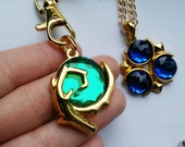The legend of zelda Kokiri's Emerald, and Zora's Sapphire necklace video game jewelry