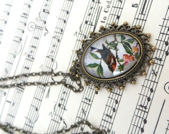 Vintage style necklace with glass pendant.