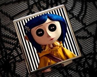 Button Eyes compact mirror