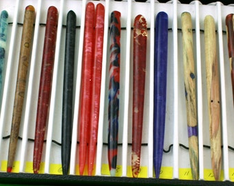 hair sticks done with a variety of materials and colors embedded in acrylic resin