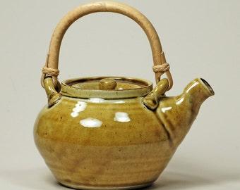 Ceramic teapot with cane handle