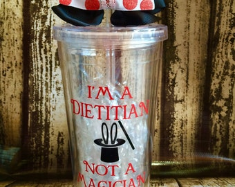 PersonalizedI'm a Dietitian, not a magician, BPA Free, Double walled, Acrylic cup with screw on lid and straw.