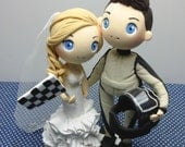 F1 car racing wedding cake topper, car racer groom hold the helmet clay figure, bride hold checked flag clay miniature, anniversary decor