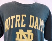 go und fightin' irish vintage 80's University of Notre Dame forest green graphic t-shirt gold yellow spellout logo print crew neck tee XL