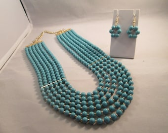 6 Strand Turquoise Bib Necklace with Gold tone Spacers and Matching Earrings