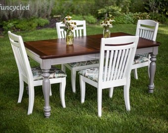 Gray and Wood Top Table With Four White Upholstered Chairs