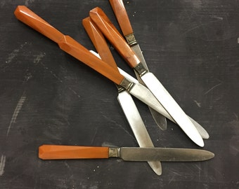 Set of vintage orange butter knives
