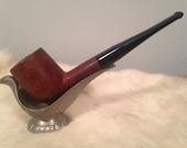 Z - This is a vintage Carey Magic Inch tobacco pipe