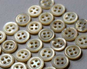 "Vintage mother of pearl. 29 matched buttons 7/16 "" approx 12 mm  white/ ecru 1920's handmade 4 hole MOP buttons excellent condition"