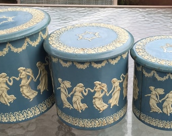Trio of vintage Wedgwood-style tin nesting canisters storage containers, embossed Grecian Three Graces ivory-colored design, Made in Holland