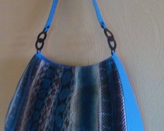 Vntage Turquoise Faux Lizard skin Handbag Purse was made by Bellini Handbgs in the 1980s