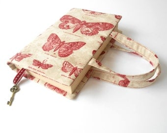 Book cover with handles and key charm. Book bag. Paperback book jacket. Book handbag. Book sleeve. Bible cover.