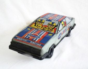 Audi Quattro vintage tin toy sports car, Turkish. Martini Racing, 1980s German Rally automobile, Red & blue, auto. Rallye Deutschland. Decor