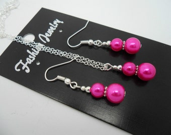 A hand made pink  glass pearl  necklace and  earring set.