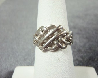 Sterling Silver 4pc Puzzle Ring Sz.6 R184