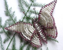 Beaded Butterfly brooch, vintage, hand beaded in clear and deep pink glass beads, hand made, with a safety pin fastener.  c early 1920's.