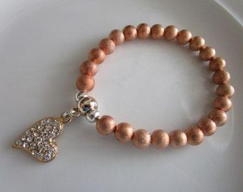 Rose pink gold colored heart charm bracelet - heart charm jewelry, rose gold bracelet, pink gold bracelet, bejeweled heart charm bracelet