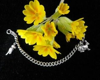 Child charm bracelet, curb chain bracelet, unmarked white metal, bird charm, rabbit charm, 1970s jewellery, 16 centimetres