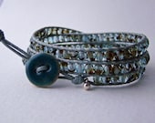 Handmade wrap bracelet with teal tortoise faceted czech glass beads with a tiny thai silver charm