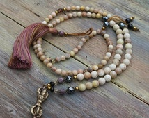 Beautiful faceted sunstone gemstone mala necklace decorated with a Nepalese dorje pendant