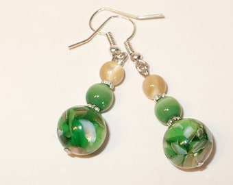 Green and beige dangle earrings with green catseye, green glass bead with mother of pearl.