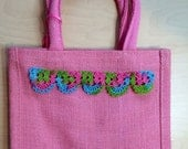 Jute bag with hand crocheted decoration