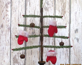 Primitive Faux German Single Feather Tree with rusty star and red pips and red  mittens