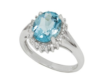 Sterling Silver Blue Topaz and Diamond Ring .01 ct, I-J, I2-I3