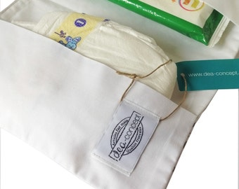 Diaper folder made of white coton with silver stars for diapers and wipes during travel