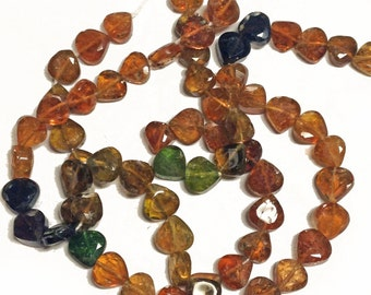 Amber tourmaline faceted briolettes.  Approx. 5x5mm - 5.5x5.5mm.  Select a quantity.