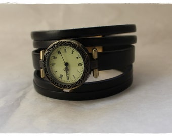 Ethnic watch on black leather