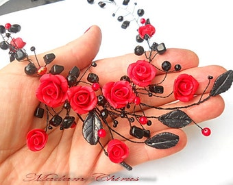 Necklace and earrings with red roses