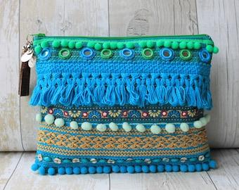 Turquoise tassel embellished clutch bag