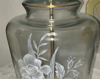 Vintage glass lamp with floral etching on the front that works