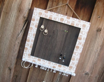 Hanging jewelry organizer for earrings, necklaces and bracelets.