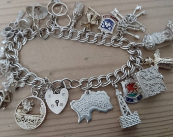 Vintage sterling silver charm bracelet with 19 charms