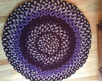 Burgundy, grape, tan circle rug