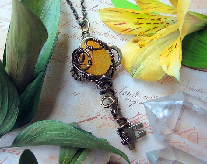 "Medium size necklace ""DreamLand"" with yellow Rutilated Quartz wire wrapped to a vintage skeleton key. Custom length chain."